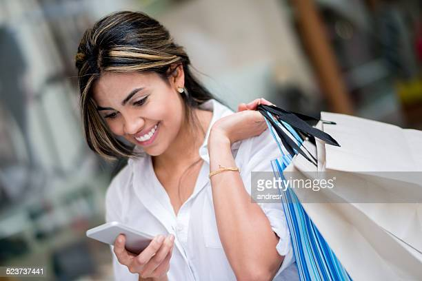 Shopping woman texting