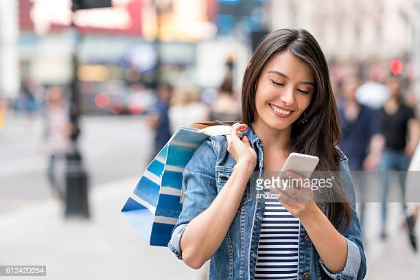 Shopping woman using app on her smart phone