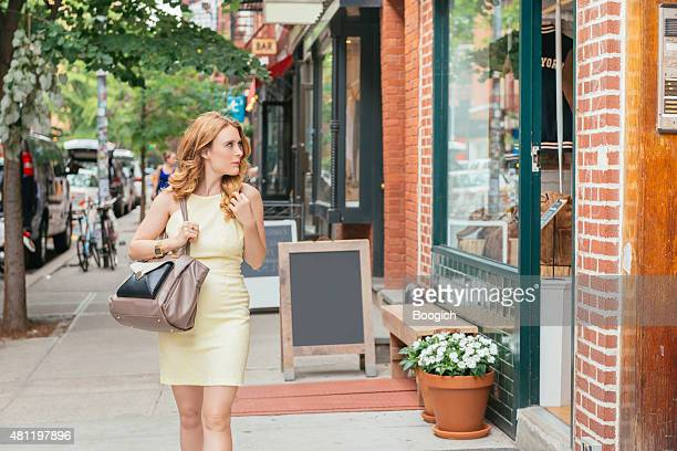 NYC Shopping Woman Walking Looks at Retail Window Displays