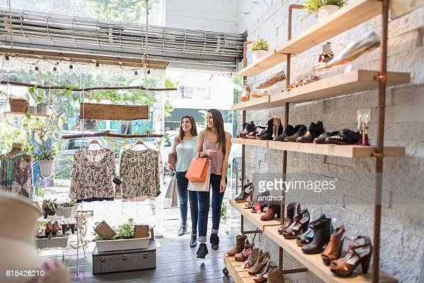 shopping women at a clothing store - spending money stock pictures, royalty-free photos & images