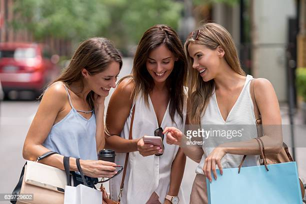 Shopping women looking at the phone