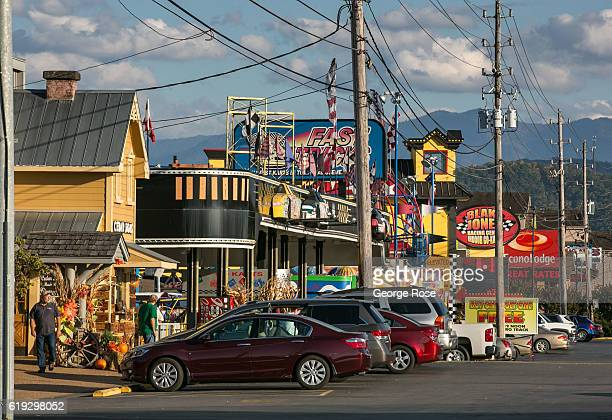 Shops and cars parked along The Parkway are viewed on October 18, 2016 in Pigeon Forge, Tennessee. Located near the entrance to Great Smoky Mountains...