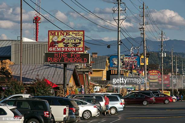Shops and cars parked along The Parkway are viewed on October 18 2016 in Pigeon Forge Tennessee Located near the entrance to Great Smoky Mountains...