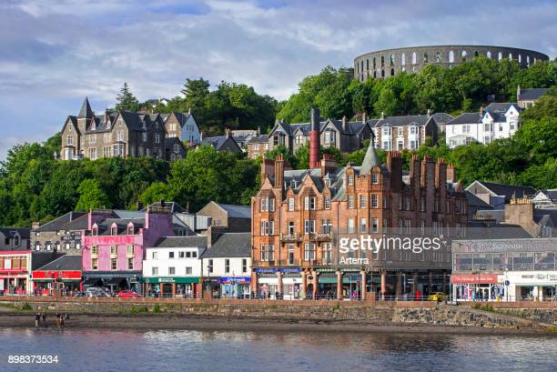 Shops and McCaig's Tower on Battery Hill overlooking the city Oban Argyll and Bute Scotland UK