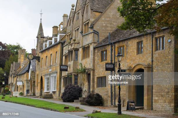 Shops and museum lining the high street in the pretty town of Broadway in the North Cotswolds, Worcestershire