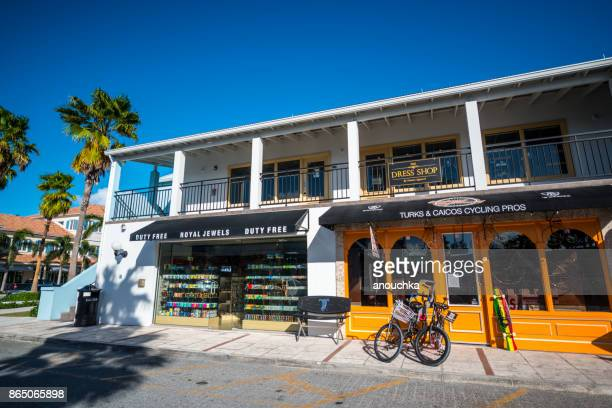 shops and rental services at saltmills plaza, providenciales. turks and caicos - grand bahama stock photos and pictures