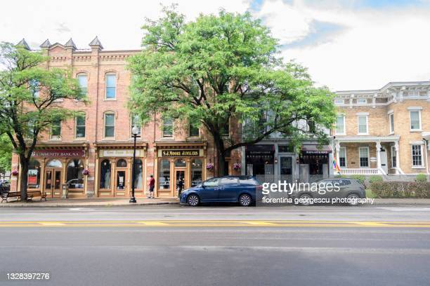 shops and restaurants on genesee street pack the town center of picturesque skaneateles, new york, usa - skaneateles lake stock pictures, royalty-free photos & images