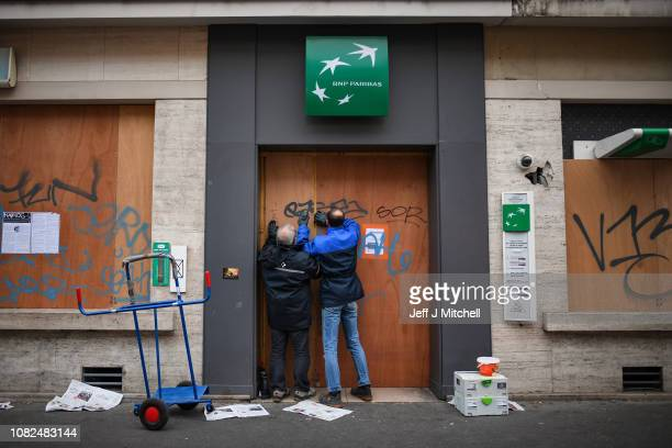 Shops are boarded up near Place de Republique ahead of tomorrow's Yellow Vest demonstrations on December 14 2018 in Paris France Despite President...