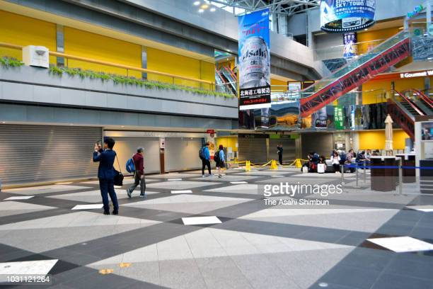 Shops are closed at Shin Chitose Airport on September 10 2018 in Chitose Hokkaido Japan Commuters hit the streets of the Hokkaido capital on their...