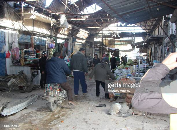 Shops are seen damaged after a missile attack carried out by Assad Regime Forces hit a marketplace in the deescalation zone of Jisr AlShughur in...