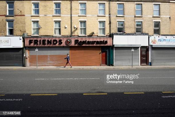 Shops are shuttered and closed as the UK begins strict lockdown measures to combat the pandemic on March 24 2020 in Liverpool England British Prime...