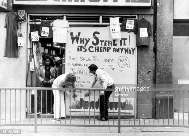 Shops boarded up and smashed in on Brixton High Street the night after the riots 11th July 1981