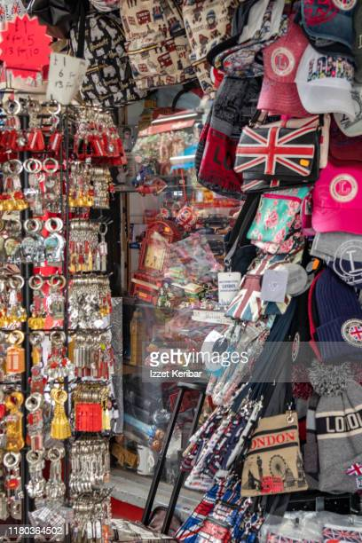 shops full of souvenirs, portobello road, lobdon uk, - greater london stock pictures, royalty-free photos & images