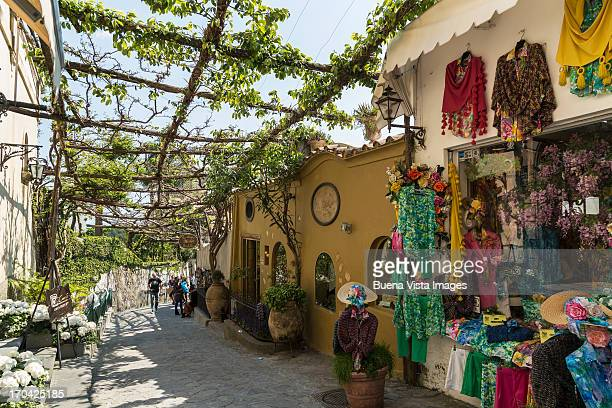 shops in a street of positano - positano fotografías e imágenes de stock