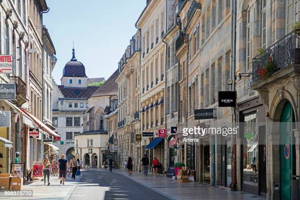 Shops in main street of the old city center of Besancon, Doubs, Bourgogne-Franche-Comte, France.