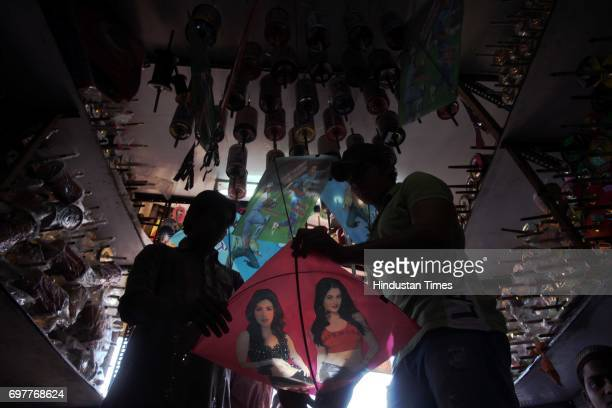 Shops in the city are thronged with kite buyers as Makar Sankranti which is on January 14th Bareilly Kite shop in Shuklaji Street show different...