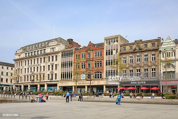 shops in the old market square in nottingham - nottingham stock photos and pictures