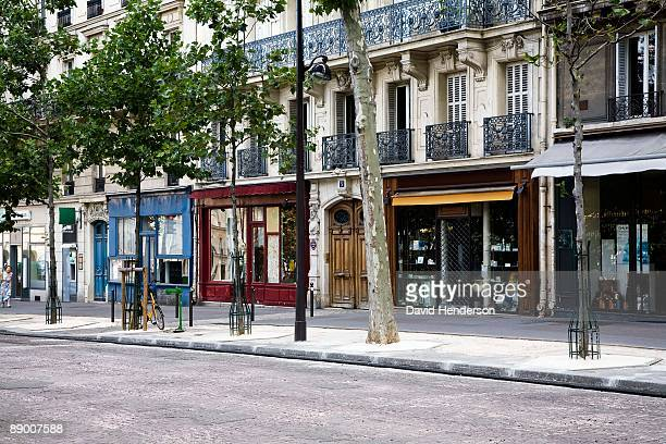 shops on boulevard saint-michel, paris, france - pavement stock pictures, royalty-free photos & images
