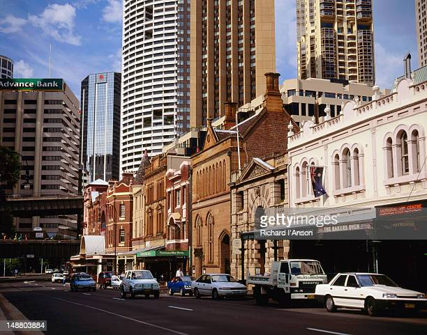 Shops on George Street, The Rocks with city buildings in background.