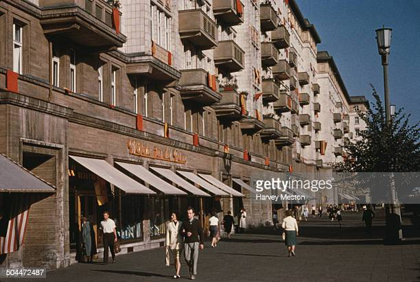 Shops on KarlMarxAllee formerly Stalinallee in East Berlin Germany circa 1965