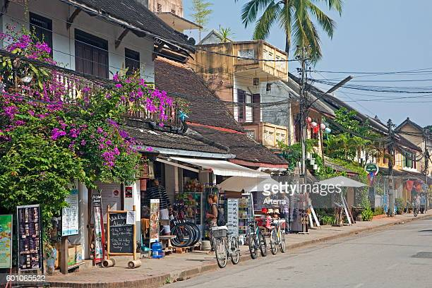 Shops renting mountain bikes for tourists and touring offices in the main street at Luang Prabang Louangphrabang Province Laos