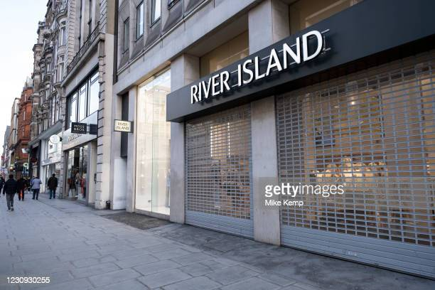 Shops with their shutters down on Oxford Street which is empty of shoppers as the national coronavirus lockdown three continues on 28th January 2021...