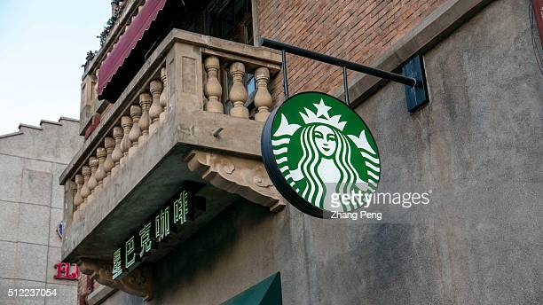 Shopsign of a Starbucks coffee house Starbucks already has nearly 2000 stores in mainland China and plans to have 3400 by 2019 laying the groundwork...