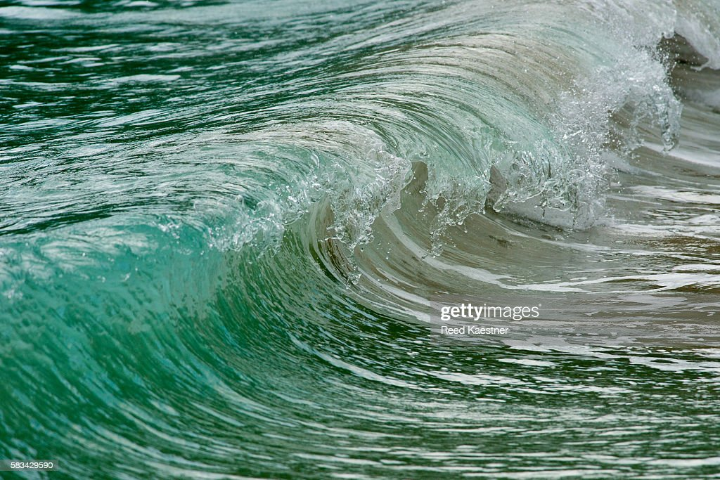 Shore break is frozen in time as it crashes on the beach : Stock Photo
