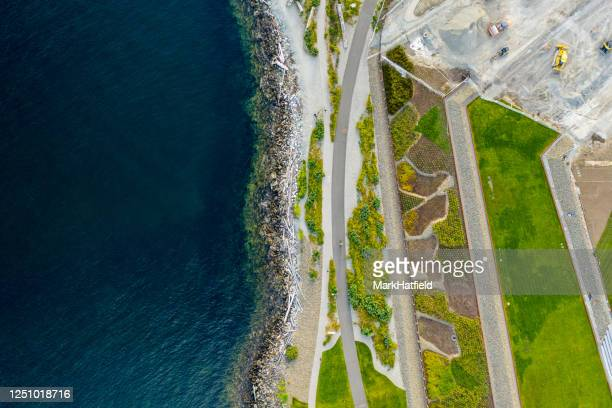 shoreline and walkway along puget sound - north pacific stock pictures, royalty-free photos & images