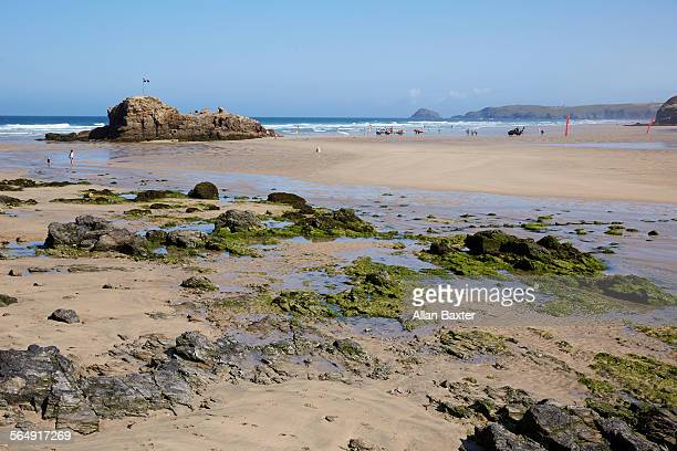shoreline of perranporth beach in cornwall - cornish flag stock pictures, royalty-free photos & images