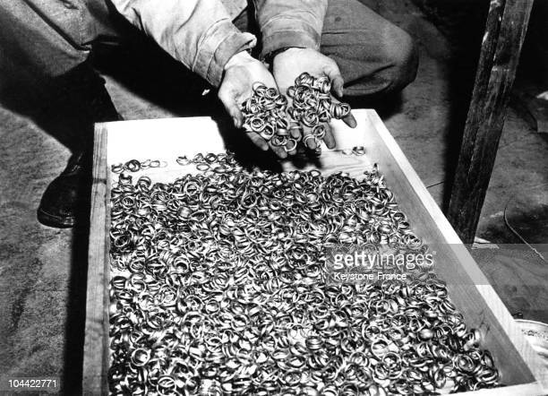Short After The Liberation Of The Nazi Concentration Camp Buchenwald Near Thuringen On April 8 An American Soldier Discovering A Box Full Of Rings Of...
