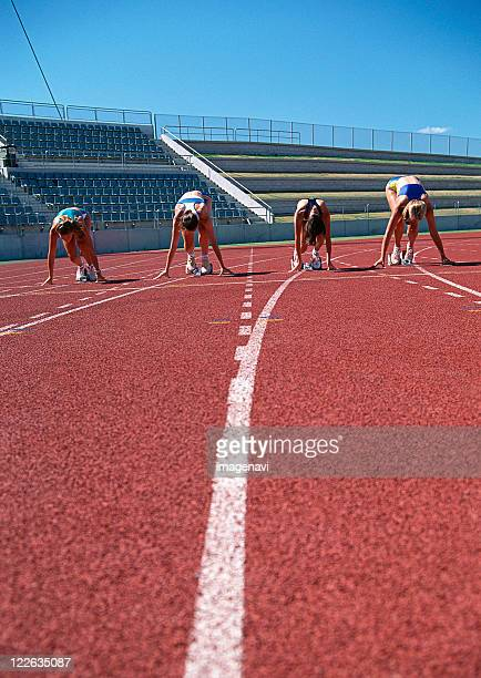 short distance race - track and field stadium stock pictures, royalty-free photos & images