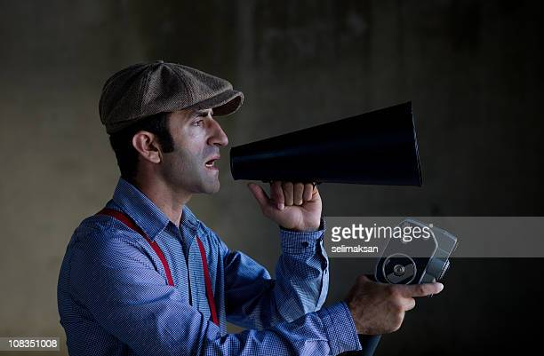 short film director in old fashioned clothes holding video camera - film director stock pictures, royalty-free photos & images