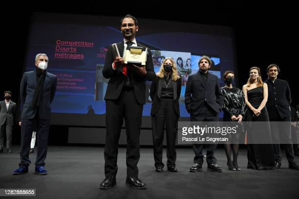 Short film Palme d'Or winner Sameh Alaa is seen on stage in front of the jury members Rachid Bouchareb, Claire Burger, Damien Bonnard, Dea...