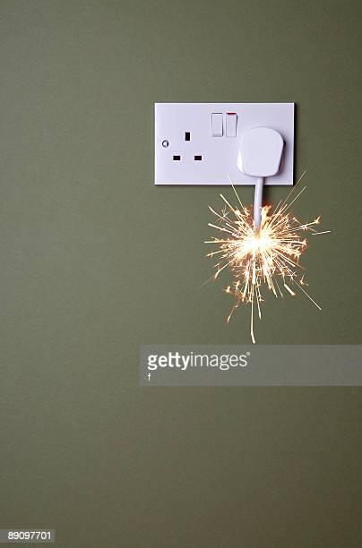 Short fuse burning towards plug socket.