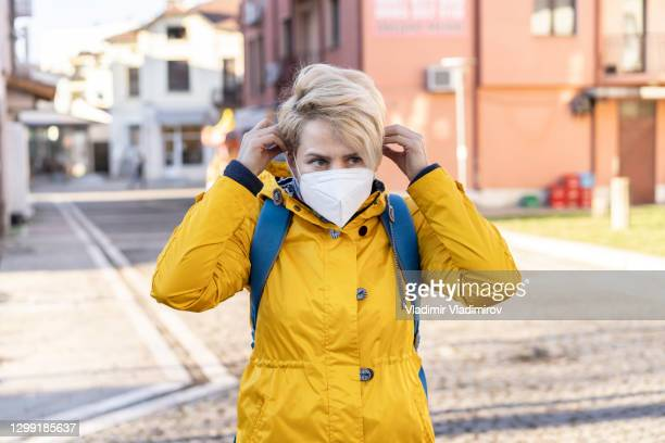 short hair woman wearing protective ffp2 mask - department of health and human services stock pictures, royalty-free photos & images