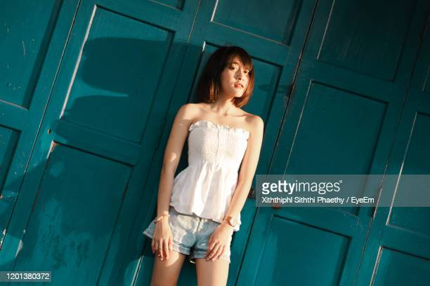 short haired girl - mini skirt stockings stock pictures, royalty-free photos & images