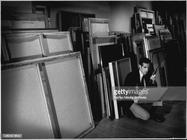 Short list for the Archibald Prize, Art GalleryMr. George Alamanos, Security Supervisor pictured with home of the hundreds of entries in the...
