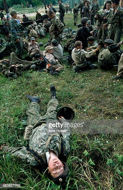 Short nap during the 45 kilometers training walk through the Moscow countryside. In 1982, facing mounting casualties among inexperienced conscripts...