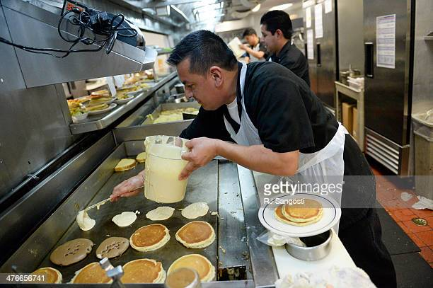 Short order cook Antonio Ruiz makes up pancakes for National Pancake Day at IHOP in Denver Tuesday March 4 2014 Since beginning its National Pancake...