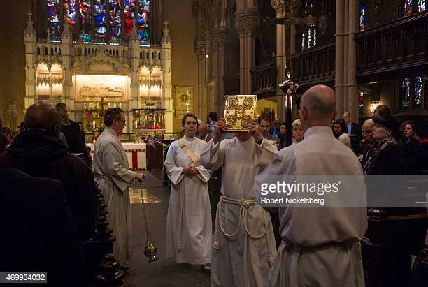 A short procession led by the crucifir takes place April 5 2015 at the St Ann and the Holy Trinity episcopal church during an Easter Day service in...