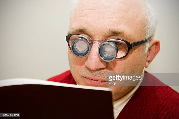 short sighted midget with special glasses - midget stock pictures, royalty-free photos & images