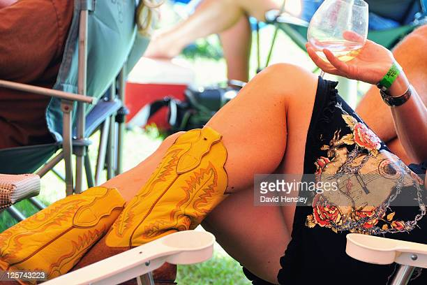 short skirts and cowgirl boots - legs and short skirt sitting down stock photos and pictures
