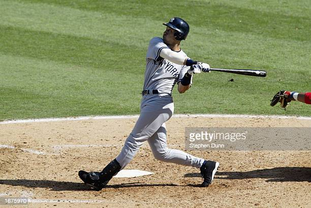 Short stop Derek Jeter of the New York Yankees swings at the pitch during game four of the American League Division Series against the Anaheim Angels...