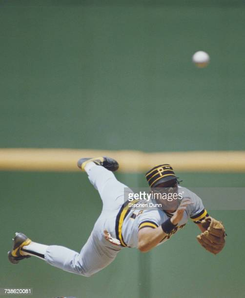 Short Stop Sam Khalifa of the Pittsburgh Pirates dives over 2nd baseman Tim Flannery of the San Diego Padres as he slides into base during their...
