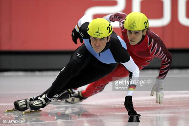 Short Track Herren men Sebastian Praus GER gegen FrancoisLouis Tremblay CAN olympische Winterspiele in Turin 2006 olympic winter games in torino 2006...