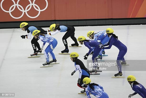 Short Track Skating: 2006 Winter Olympics, South Korea Chun-Sa Byun and Yun-Mi Kang in action vs Italy Marta Capurso and Arianna Fontana during...
