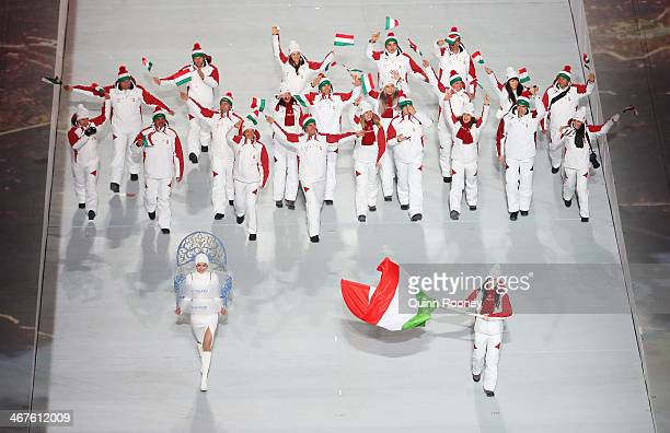 Short track speed skater Bernadett Heidum of the Hungary Olympic team carries her country's flag during the Opening Ceremony of the Sochi 2014 Winter...