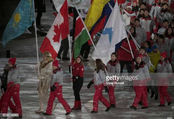 PYEONGCHANG FEBRUARY 25 Short Track Speed Skater Kim Boutin carries in the flag for Canada during the closing ceremonies at the 2018 Pyeongchang...