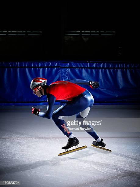 Short track speed skater preparing to start sprint